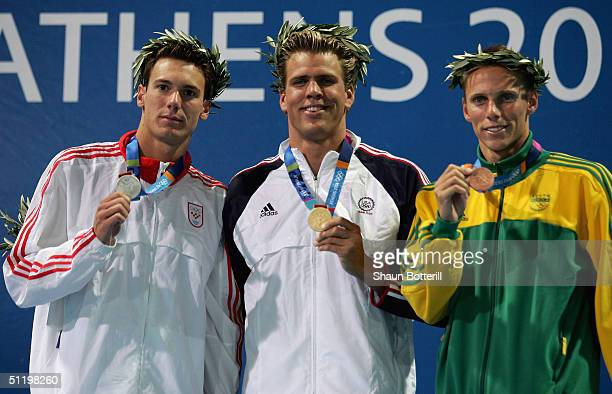 Silver medalist Duje Draganja of Croatia gold medalist Gary Hall Jr of the United States and bronze medalist Roland Mark Schoeman of South Africa...