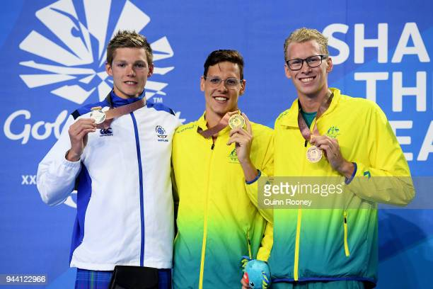 Silver medalist Duncan Scott of Scotland gold medalist Mitch Larkin of Australia and bronze medalist Clyde Lewis of Australia pose during the medal...