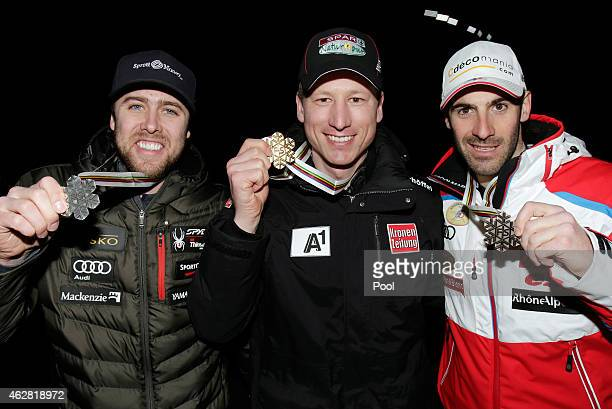 Silver medalist Dustin Cook of Canada gold medalist Hannes Reichler of Austria and bronze medalist Adrien Theaux of France pose following the medals...