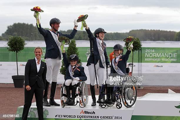 Silver medalist Dutch team Franck Hosmar Sanne Voets Demi Vermeulen and Rixt van der Horst celebrate on the podium during the medal ceremony of the...