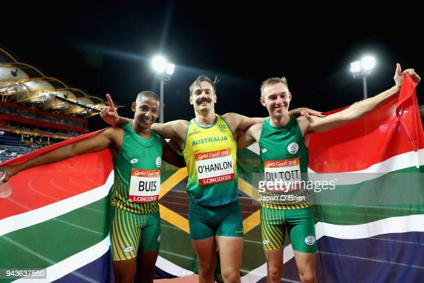 Silver medalist Dyan Buis of South Africa gold medalist Evan O'Hanlon of and bronze medalist Charl du Toit of South Africa celebrate after the Men's...
