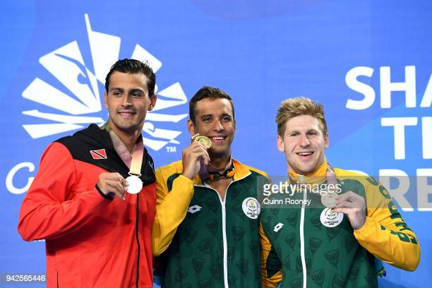 Silver medalist Dylan Carter of Trinidad and Tobago gold medalist Chad le Clos of South Africa and bronze medalist Ryan Coetzee of South Africa pose...