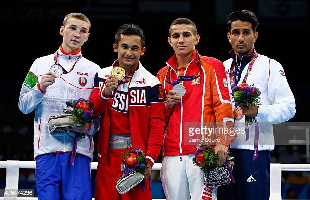 Silver medalist Dzmitry Asanau of Belarus gold medalist Bakhtovar Nazirov of Russia and bronze medalists Tayfur Aliyev of Azerbaijan and Ashfaq Qais...