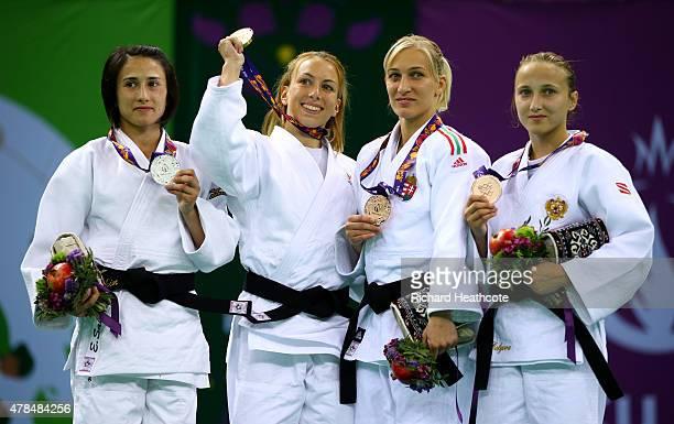 Silver medalist Ebru Sahin of Turkey gold medalist Charline van Snick of Belgium bronze medalist Eva Csernoviczki of Hungary and bronze medalist...
