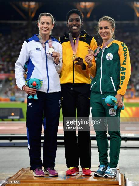 Silver medalist Eilidh Doyle of Scotland gold medalist Janieve Russell of Jamaica and bronze medalist Wenda Nel of South Africa pose during the medal...