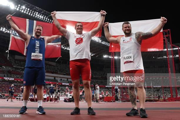 Silver medalist Eivind Henriksen of Team Norway, gold medalist Wojciech Nowicki of Team Poland and bronze medalist Pawel Fajdek of Team Poland...