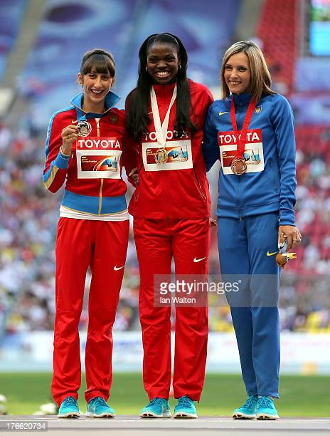 Silver medalist Ekaterina Koneva of Russia gold medalist Caterine Ibarguen of Colombia and bronze medalist Olha Saladuha of Ukraine stand on the...