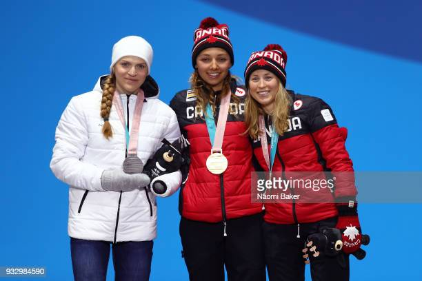Silver medalist Ekaterina Rumyantseva of Neutral Paralympic Athlete gold medalist Natalie Wilkie of Canada and bronze medalist Emily Young of Canada...
