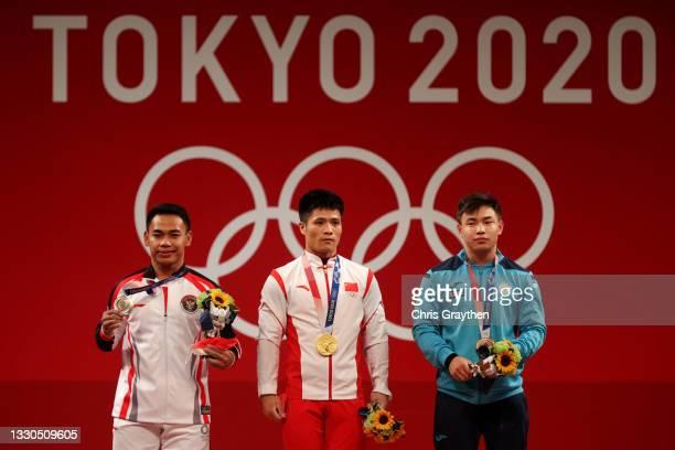 Silver medalist Eko Yuli Irawan of Team Indonesia, gold medalist Fabin Li of Team China and bronze medalist Igor Son of Team Kazakhstan pose on the...