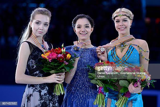 Silver medalist Elena Radionova of Russia gold medalist Evgenia Medvedeva of Russia and bronze medalist Anna Pogorilaya of Russia pose during the...