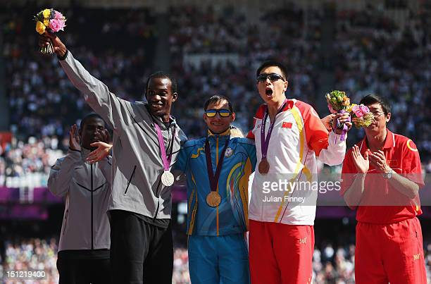 Silver medalist Elexis Gillette of the United States, Gold medalist Ruslan Katyshev of Ukraine and bronze medalist Duan Li of China pose on the...