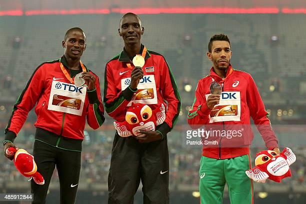 Silver medalist Elijah Motonei Manangoi of Kenya, gold medalist Asbel Kiprop of Kenya and bronze medalist Abdalaati Iguider of Morocco pose on the...