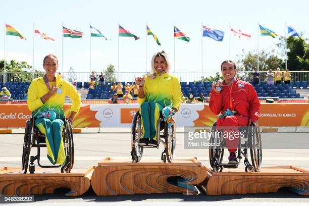 Silver medalist Eliza Ault-Connell of Australia, gold medalist Madison de Rozario of Australia and bronze medalist Jade Jones of England look on...