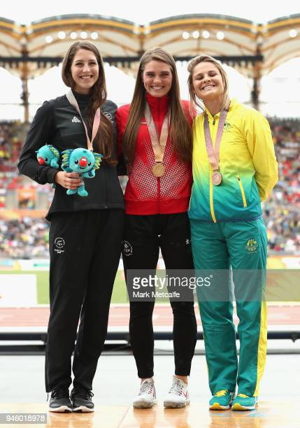 Silver medalist Eliza McCartney of New Zealand gold medalist Alysa Newman of Canada and bronze medalist Nina Kennedy of Australia pose during the...