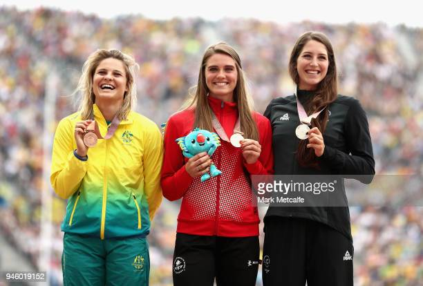 Silver medalist Eliza McCartney of New Zealand, gold medalist Alysa Newman of Canada and bronze medalist Nina Kennedy of Australia pose during the...