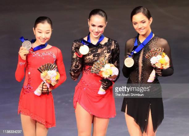 Silver medalist Elizabet Tursynbaeva of Kazakhstan gold medalist Alina Zagitova of Russia and bronze medalist Evgenia Medvedeva of Russia pose for...