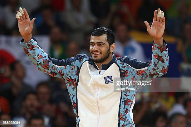 Silver medalist Elmar Gasimov of Azerbaijan celebrates on the podium after the men's 100kg gold medal judo contest against Lukas Krpalek of the Czech...