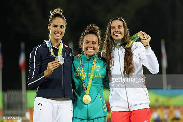 Silver medalist Elodie Clouvel of France, gold medalist Chloe Esposito of Australia and bronze medalist Oktawia Nowacka of Poland pose on the podium...