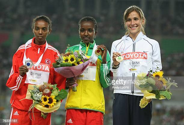 Silver medalist Elvan Abeylegesse of Turkey gold medalist Tirunesh Dibaba of Ethiopia and Kara Goucher of the United States of America receive their...