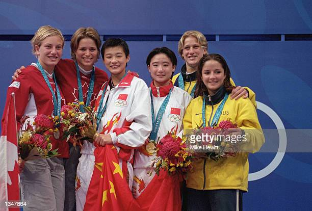 Silver medalist Emile Heymans Anne Montminy of Canada pose with Gold medalist Li Na Sang Xue of China and Bronze medalist Rebecca Gilmore Loudy...