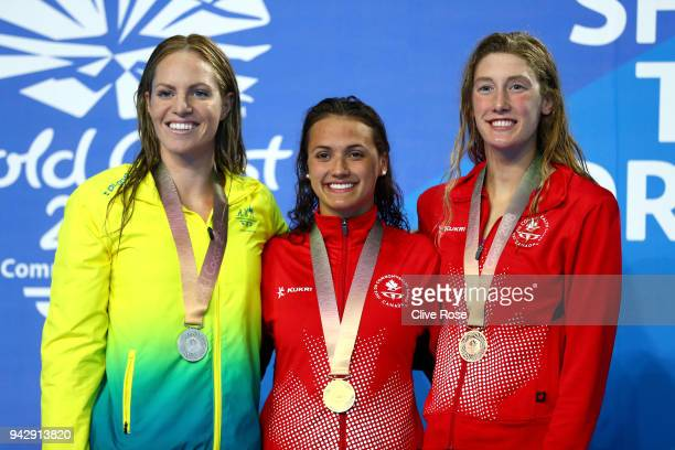 Silver medalist Emily Seebohm of Australia gold medalist Kylie Masse of Canada and bronze medalist Taylor Ruck of Canada pose during the medal...