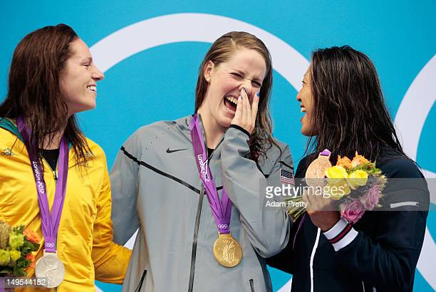 Silver medalist Emily Seebohm of Australia gold medalist Missy Franklin of the UNited States and bronze medalist Aya Terakawa of Japan celebrate with...