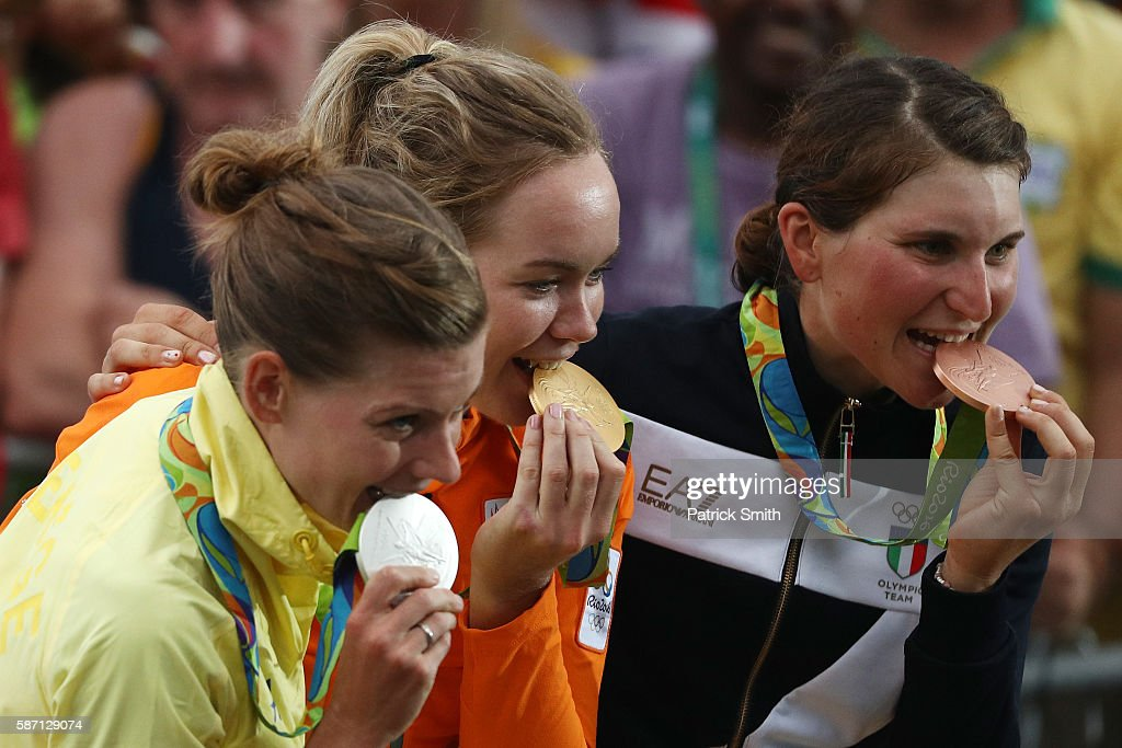 Silver medalist Emma Johansson of Sweden, gold medalist Anna van der Breggen of the Netherlands and bronze medalist Elisa Longo Borghini of Italy bite their medals as they pose for a photo on the podium following the Women's Road Race on Day 2 of the Rio 2016 Olympic Games at Fort Copacabana on August 7, 2016 in Rio de Janeiro, Brazil.
