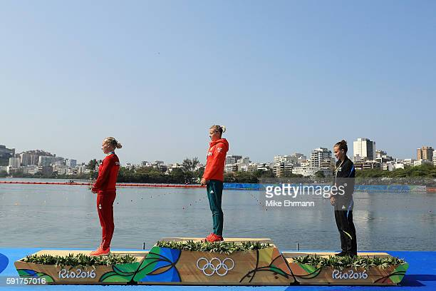 Silver medalist Emma Jorgensen of Denmark gold medalist Danuta Kozak of Hungary and Lisa Carrington of New Zealand stand on the podium during the...