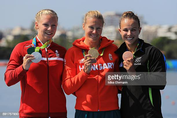 Silver medalist Emma Jorgensen of Denmark gold medalist Danuta Kozak of Hungary and bronze medalist Lisa Carrington of New Zealand stand on the...
