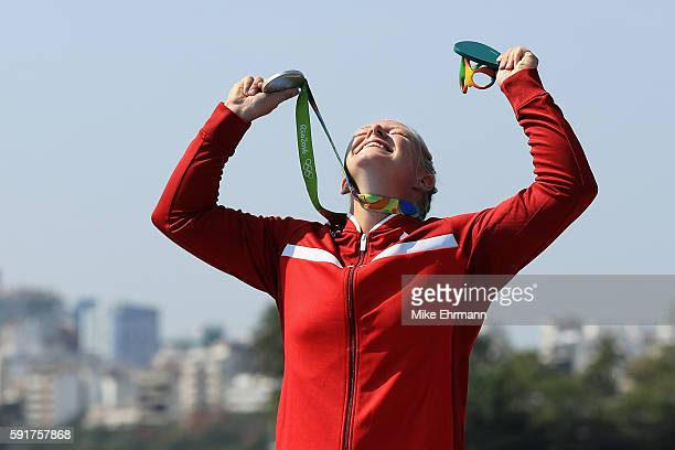 Silver medalist Emma Jorgensen of Denmark stands on the podium during the medal ceremony for the Women's Kayak Single 500m event at the Lagoa Stadium...
