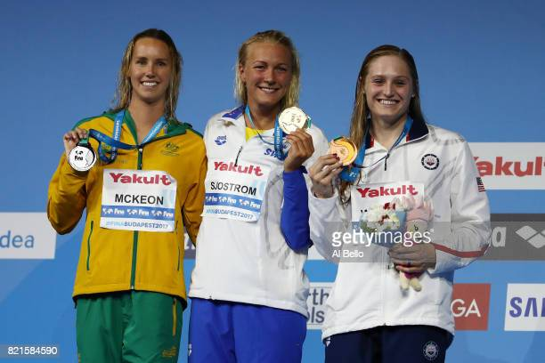 Silver medalist Emma Mckeon of Australia gold medalist Sarah Sjostrom of Sweden and bronze medalist Kelsi Worrell of the United States pose with the...