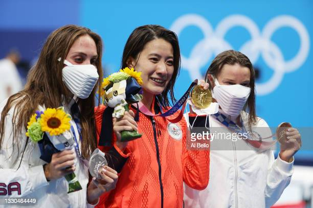 Silver medalist Emma Weyant of Team United States, gold medalist Yui Ohashi of Team Japan and bronze medalist Hali Flickinger of Team United States...