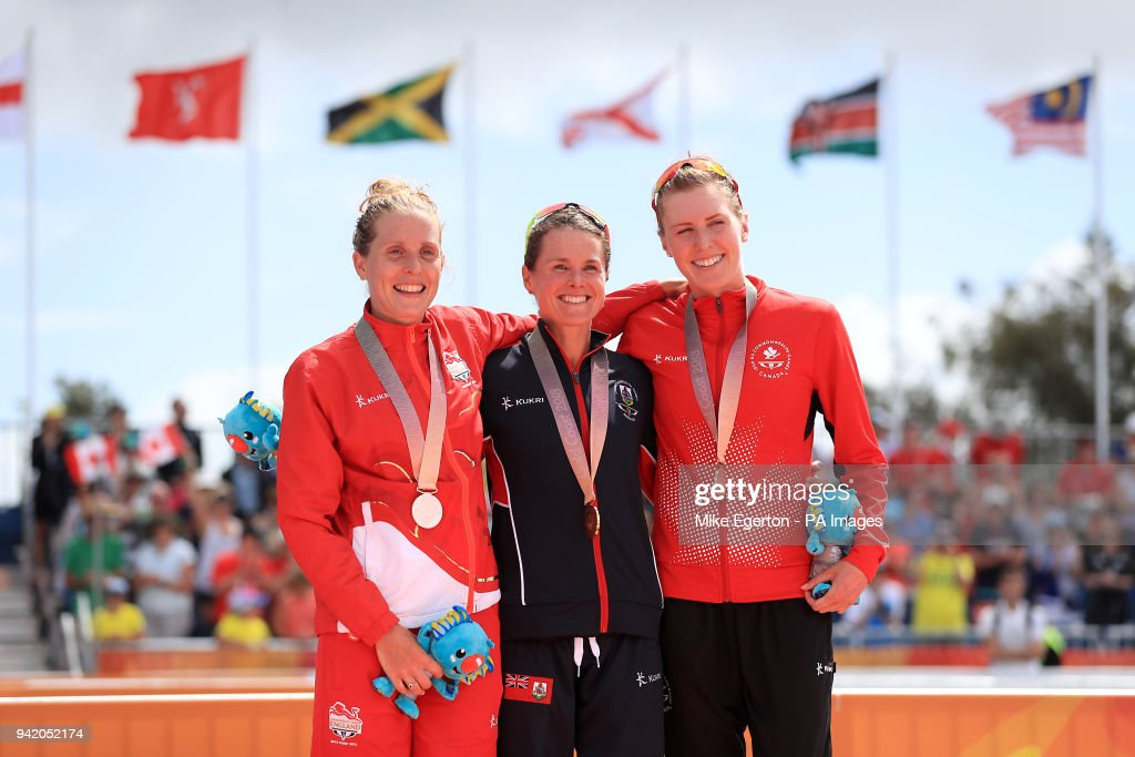 Silver medalist England's Jessica Learmonth, gold medalist Bermuda's Flora Duffy and bronze medalist Canada's Joanna Brown on the podium after the Women's Triathlon Final at the Southport Broadwater Parklands during day one of the 2018 Commonwealth Games in the Gold Coast, Australia.