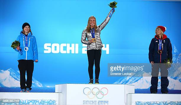 Silver medalist Enni Rukajarvi of Finland gold medalist Jamie Anderson of the United States and bronze medalist Jenny Jones of Great Britain pose on...