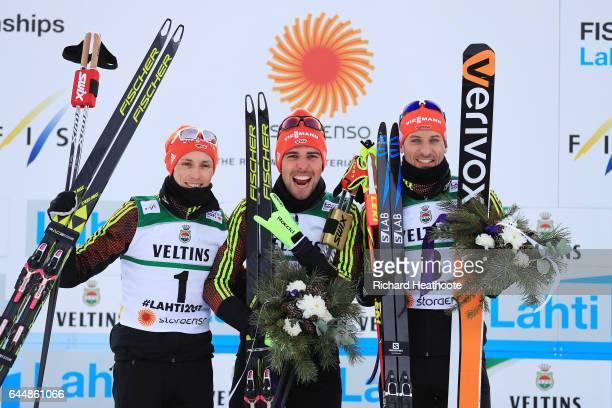 Silver medalist Eric Frenzel of Germany gold medalist Johannes Rydzek of Germany and bronze medalist Bjoern Kircheisen of Germany celebrate following...