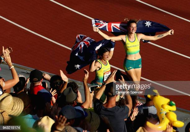 Silver medalist Erin Cleaver of Australia and bronze medalist Taylor Doyle of Australia celebrate after the Women's T38 Long Jump Final on day four...