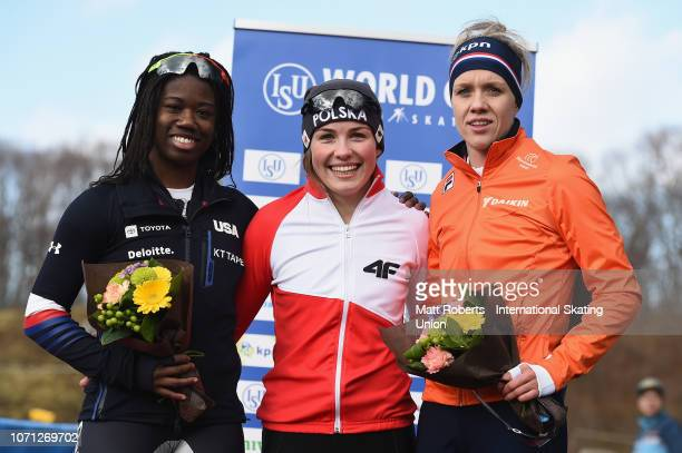 Silver medalist Erin Jackson of USA gold medalist Kaja Ziomek of Poland and bronze medalist Letitia de Jong of Netherlands pose during the medal...