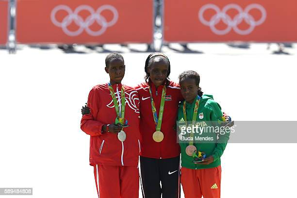 Silver medalist Eunice Jepkirui Kirwa of Bahrain gold medalist Jemima Jelagat Sumgong of Kenya and bronze medalist Mare Dibaba of Ethiopia pose...