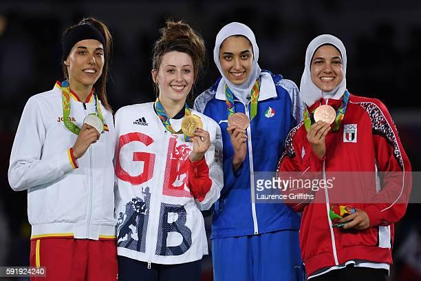 Silver medalist Eva Calvo Gomez of Spain gold medalist Jade Jones of Great Britain and bronze medalists Kimia Alizadeh Zenoorin and Hedaya Wahba of...