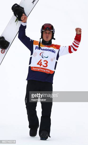 Silver Medalist Evan Strong of the United States celebrates during the victory ceremony for the Men's Snowboard Banked Slalom SBLL2 during day seven...