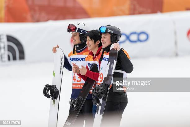 Silver Medalist Evan Strong of the United States Gold Medalist Grimu Narita of Japan and Bronze Medalist Matti SUURHAMARI of Finland celebrate during...