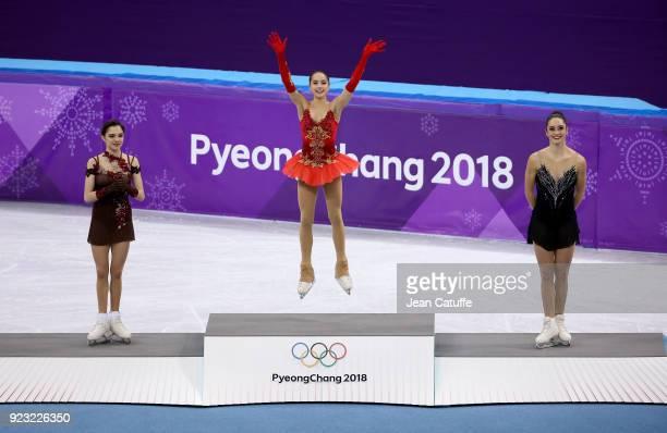 Silver medalist Evgenia Medvedeva of Olympic Athlete from Russia, gold medalist Alina Zagitova of Olympic Athlete from Russia, bronze medalist...