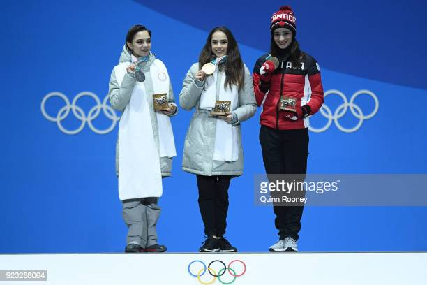 Silver medalist Evgenia Medvedeva of Olympic Athlete from Russia gold medalist Alina Zagitova of Olympic Athlete from Russia and bronze medalist...
