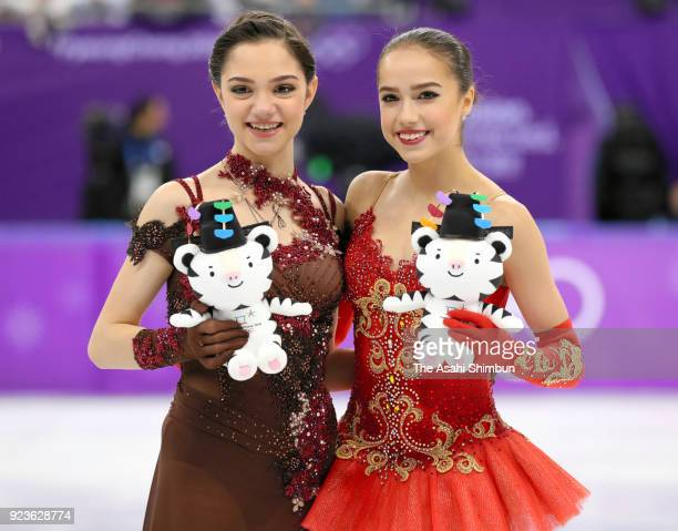 Silver medalist Evgenia Medvedeva of Olympic Athlete from Russia gold medalist Alina Zagitova of Olympic Athlete from Russia celebrate at the victory...