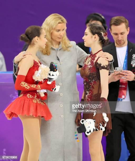 Silver medalist Evgenia Medvedeva of Olympic Athlete from Russia gold medalist Alina Zagitova of Olympic Athlete from Russia is congratulated by...