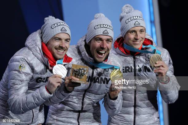 Silver medalist Fabian Riessle of Germany gold medalist Johannes Rydzek of Germany and bronze medalist Eric Frenzel of Germany celebrate during the...
