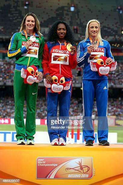 Silver medalist Fabiana Murer of Brazil gold medalist Yarisley Silva of Cuba and bronze medalist Nikoleta Kyriakopoulou of Greece pose on the podium...