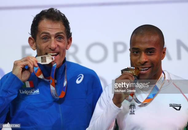 Silver medalist Fabrizio Donato of Italy and gold medalist Evora Nelson of Portugal pose during the medal ceremony for the Men's Triple Jump on day...