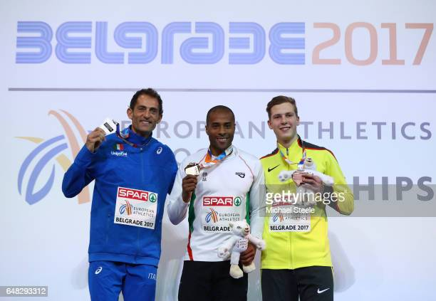 Silver medalist Fabrizio Donato of Italy gold medalist Evora Nelson of Portugal and bronze medalist Max Hess of Germany pose during the medal...