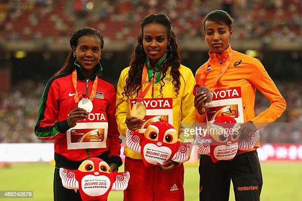 Silver medalist Faith Chepngetich Kipyegon of Kenya gold medalist Genzebe Dibaba of Ethiopia and bronze medalist Sifan Hassan of the Netherlands pose...